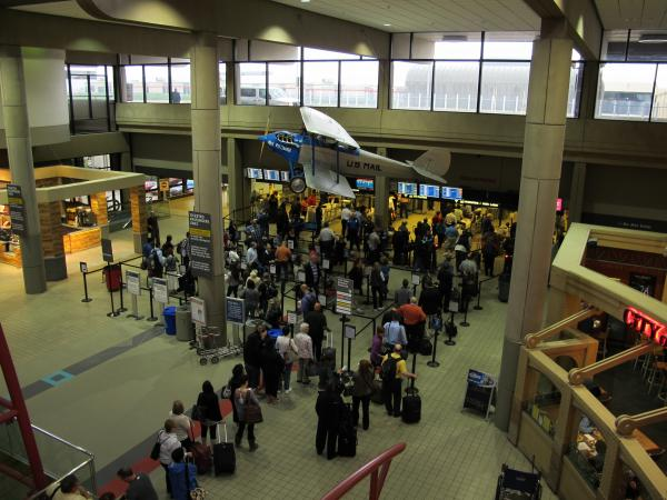 Travelers should expect longer screening lines after the sequester hits on Friday.
