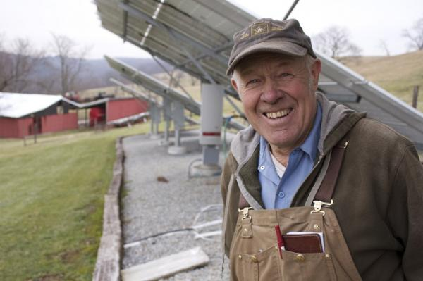 Duane Miller in front of the solar array he installed to reduce his energy bills.