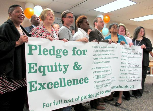 Candidates for Pittsburgh School Board stand behind the signed Equity and Excellence Pledge. Candidate Thomas Sumpter (District 3) was not in attendance but had signed the pledge previously.