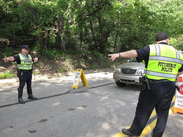 Pittsburgh Police officers conduct a safety inspection as part of the Click It or Ticket kick-off. The Click It or Ticket seat belt enforcement campaign runs through June 9.