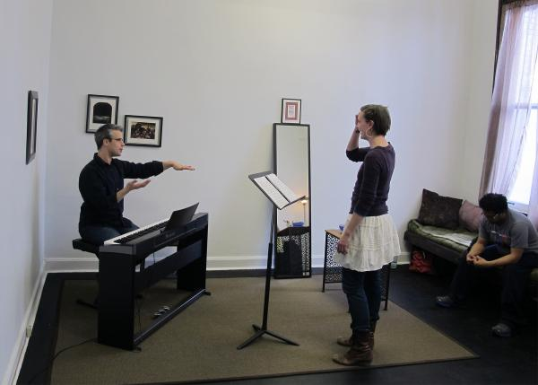 Dan Teadt (left) works with students Laura Totten and Amit Chakrabarti at his voice studio in East Liberty.