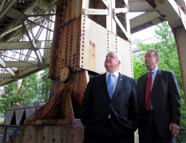 Governor Tom Corbett and PA Transportation Secretary Barry Schoch look at the underside of the Liberty Bridge, which is one of 4,000 structurally deficient bridges in the state.