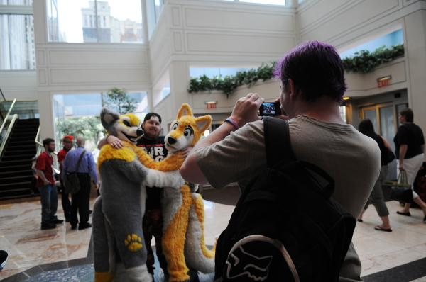 Sam Parga, 30, of LaGrange, Ga., snaps a photo of friends Wednesday in the run-up to Anthrocon at the Westin Convention Center Hotel.