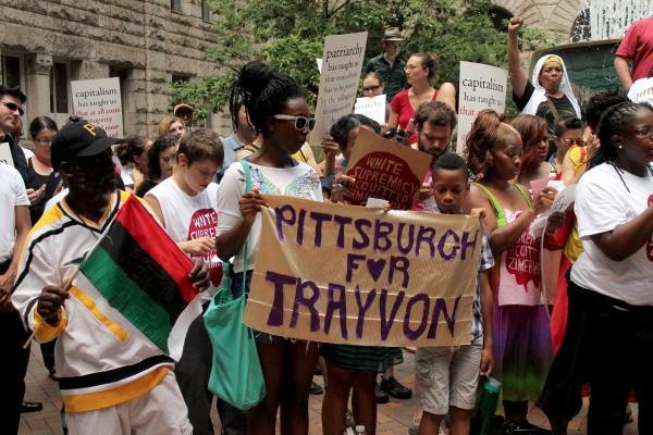 Protesters rally inside the courtyard of the Allegheny County  Courthouse Wednesday.
