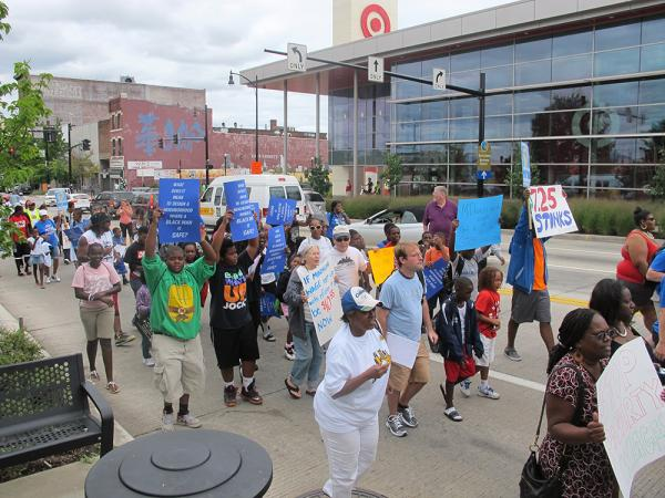 Protesters rally outside the East Liberty Target Wednesday.