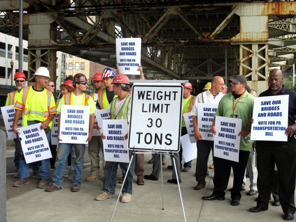 Labor and business leaders were joined by workers calling on the state House to pass a transportation funding plan in the fall.
