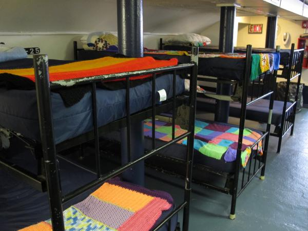 Knitted and crocheted panels from the Pittsburgh Knit the Bridge project add a splash of color and comfort to shelter beds at the Light of Life Rescue Mission on the North Side.