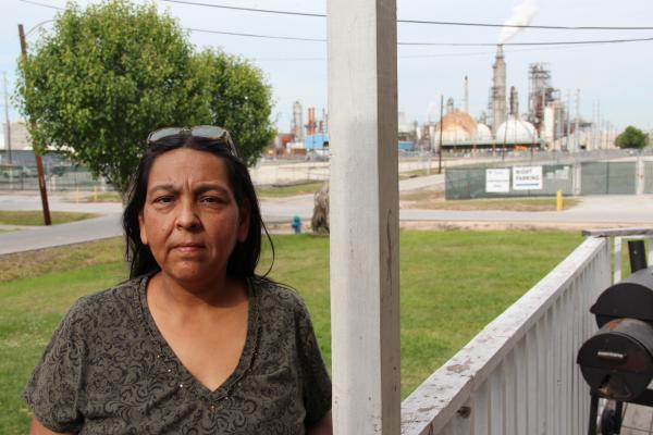 Apollonia Martinez on her front porch in Manchester, TX, a community next to the Houston Ship Channel, said her son has asthma attacks from air pollution. Photo: Reid R. Frazier