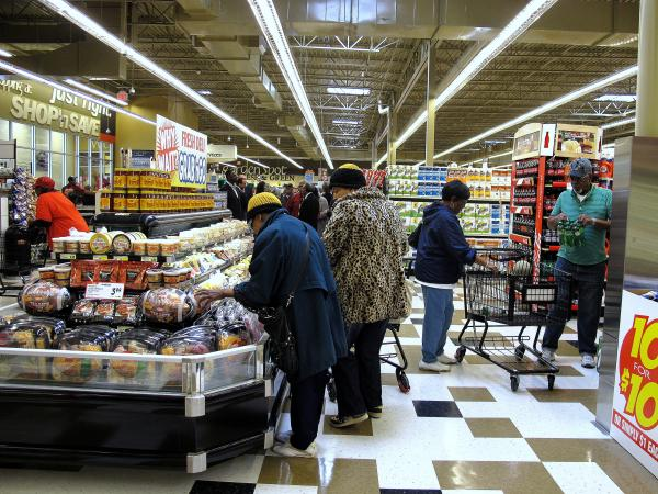 Shoppers peruse the prepared foods section in the Hill District's new full-service grocery store.