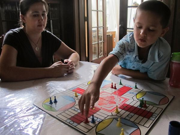 Robyn Barber and her 7-year-old son Zachary like to play Parcheesi at their Observatory Hill home.