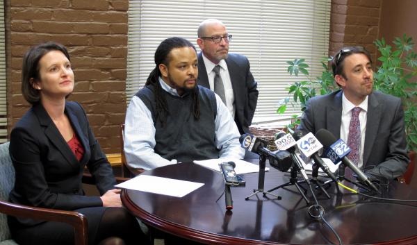 Dennis Henderson (center) and the ACLU have filed a federal lawsuit against a Pittsburgh police officer following an incident in Homewood last summer.