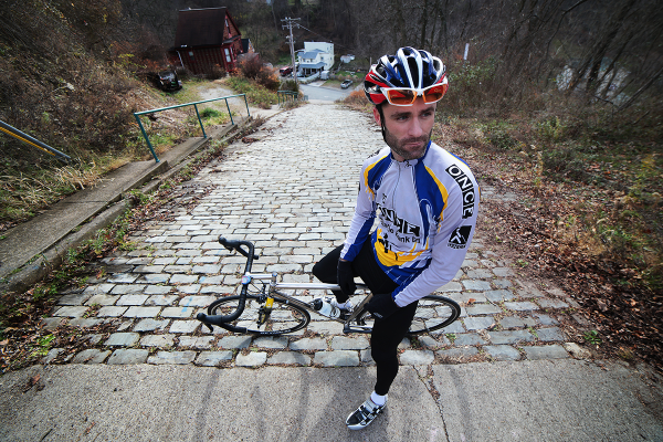 "Pete Buryk, 32, of Mt. Lebanon, will compete in the Dirty Dozen race this weekend. Photographed at the top of the city's steepest paved street — Canton Avenue — this will be Buryk's first time competing in the event. ""It seems cliche,"" he said, ""but it's the ultimate bike challenge around here."""