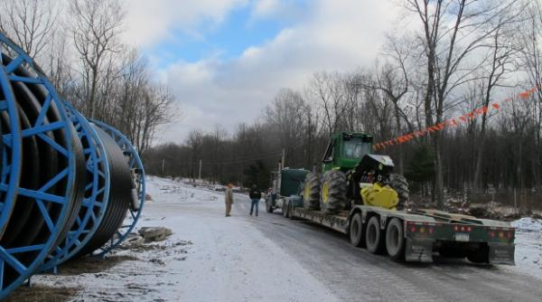 A truck moves heavy equipment through the Tiadaghton State Forest in Lycoming County.