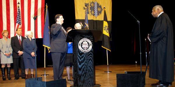Bill Peduto takes the oath of office at Heinz Hall. Judge Justin Johnson administered the oath, the Bible was held by Max and Sue Sciullo, the parents of a slain Pittsburgh police officer.