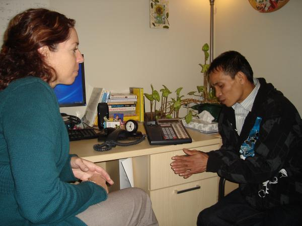 Therapist Julanne Bibro-Ruch works with Adu Sit, a Burmese refugee, at the Squirrel Hill Health Center. On the speaker phone is an interpreter.