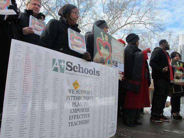 Activists rally outside Pittsburgh King PreK-8 School on the North Side Monday morning.