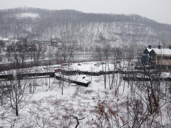 Officials say as much as 3,000 gallons of crude oil were spilled following this morning's train derailment in Vandergrift, but all of it was contained in a parking lot.