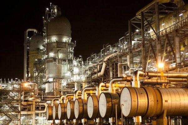 """The stabilization of the natural gas boom may lead to opportunities for downstream industries, bringing petrochemical processing and related manufacturing stateside. Seen here, an ethalyne """"cracker"""" in Singapore."""