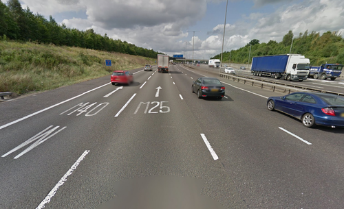 The road signs painted on this highway in the UK are one potential approach to better signage proposed in the PghRoads blog