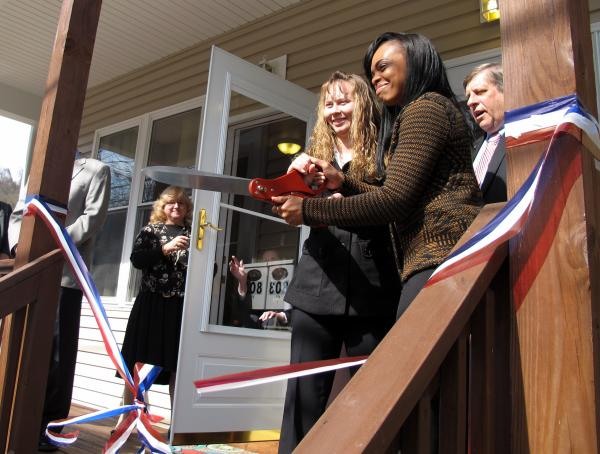 Khrystal Brown (right) and another veteran cut the ribbon on the newest housing units for women vets.