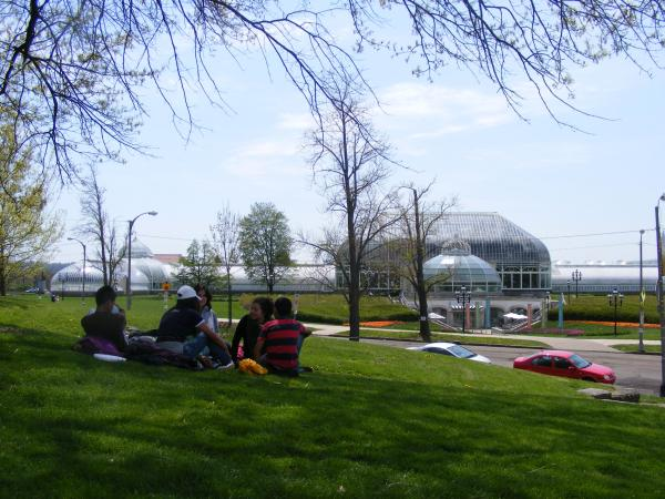 Ecuadorian students and adults lounge outside of Phipps Conservatory