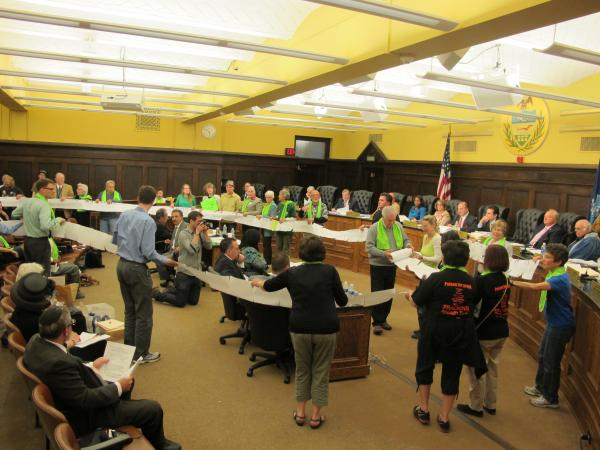 At Tuesday's County Council meeting, environmental activists from Protect Our Parks unrolled a petition that they said contains the signatures of 7,500 people who oppose drilling under Deer Lakes Park.