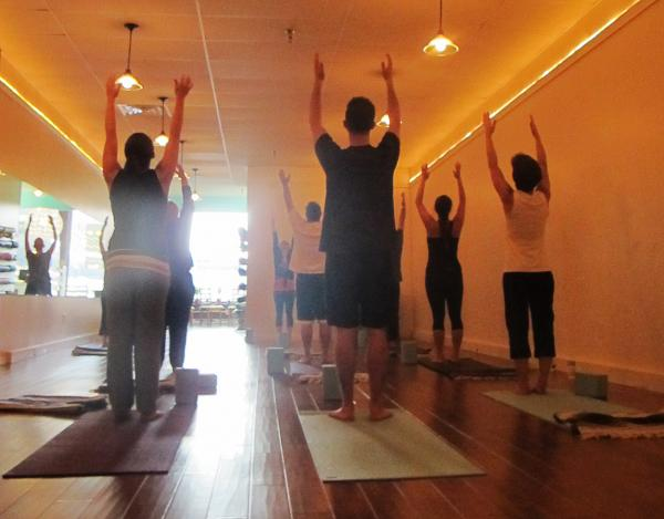 Students participate in a class at Bend Yoga in downtown Pittsburgh.