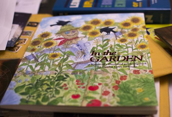 Author Sandra McPeake wants you to take her book with you into the garden.