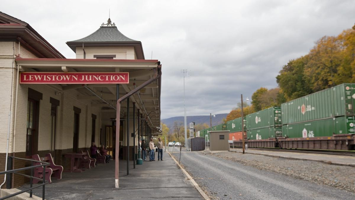 Proposal to expand passenger rail west to harrisburg gains passengers wait to board an amtrak train at the lewistown station in central pennsylvania there sciox Images
