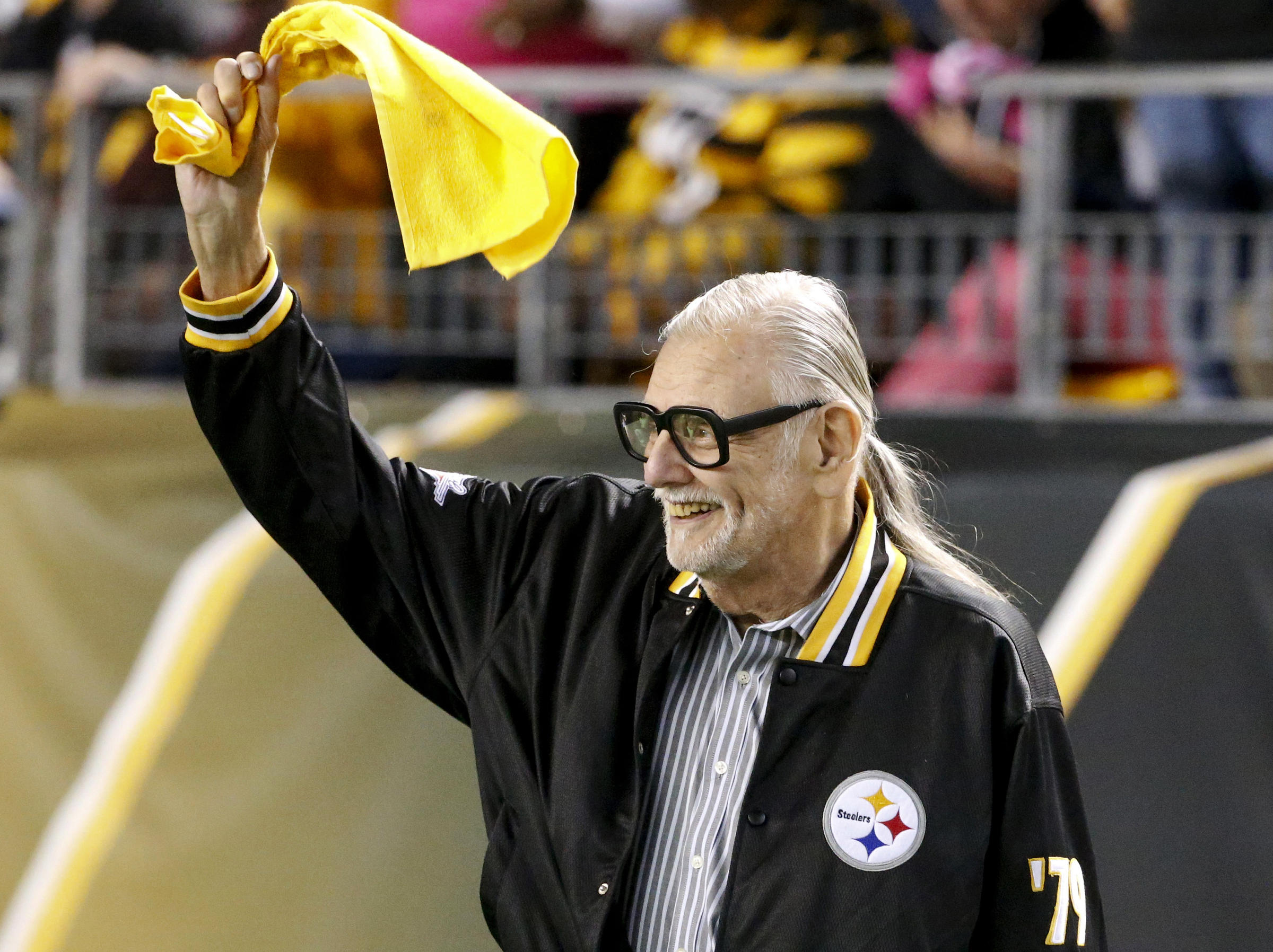 George Romero waves a terrible towel at a Pittsburgh Steelers game against the Baltimore Ravens
