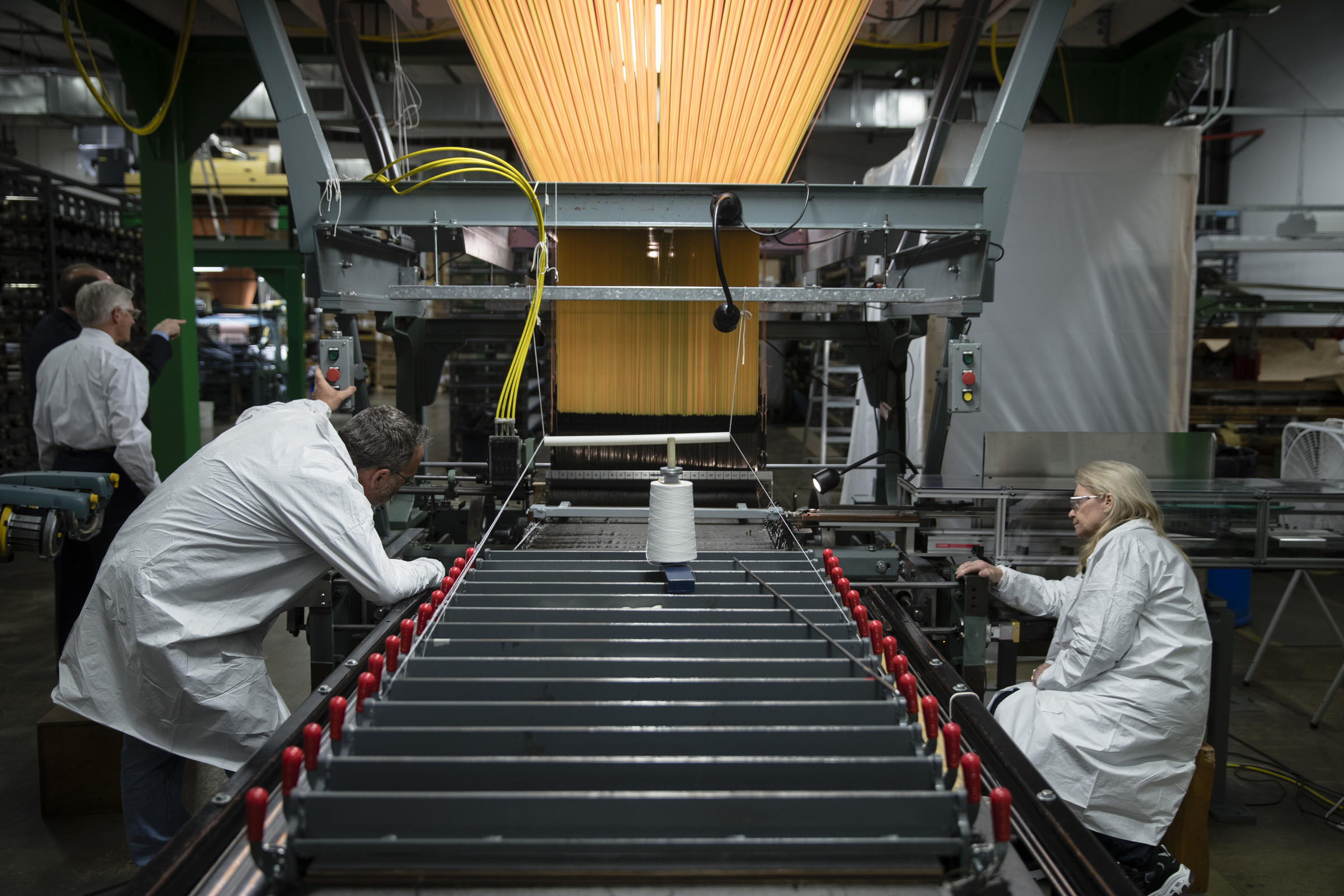 Workers manufacture thermal protection systems for NASA at Bally Ribbon Mills in Bally, Pa.