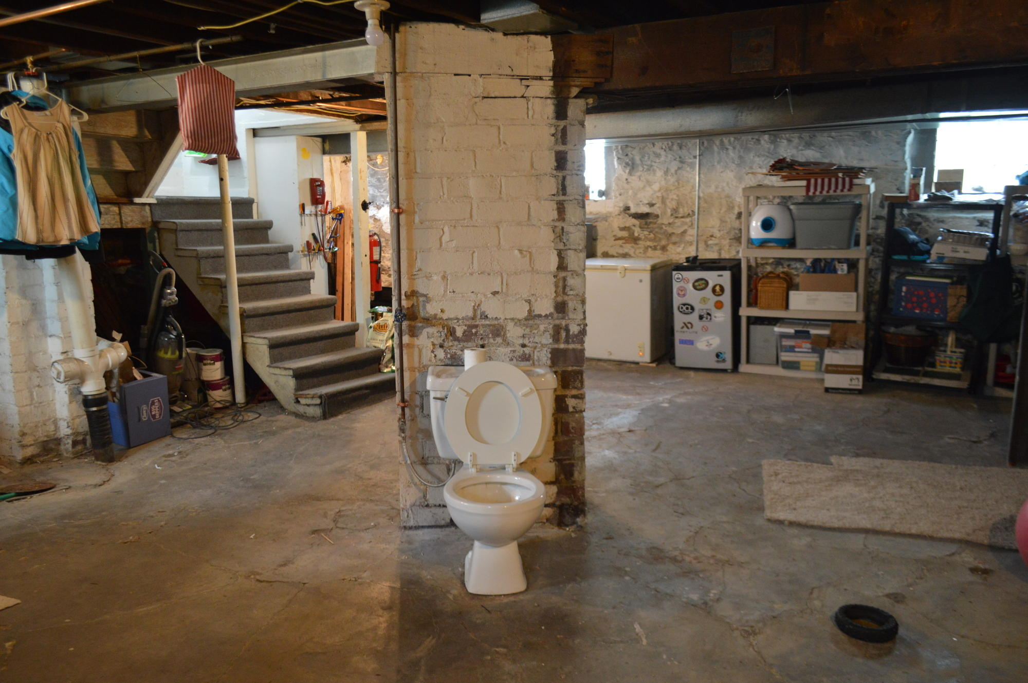 basement. A Lone Pittsburgh Potty Sits Behind Pillar In Bridgeville Basement. Basement H