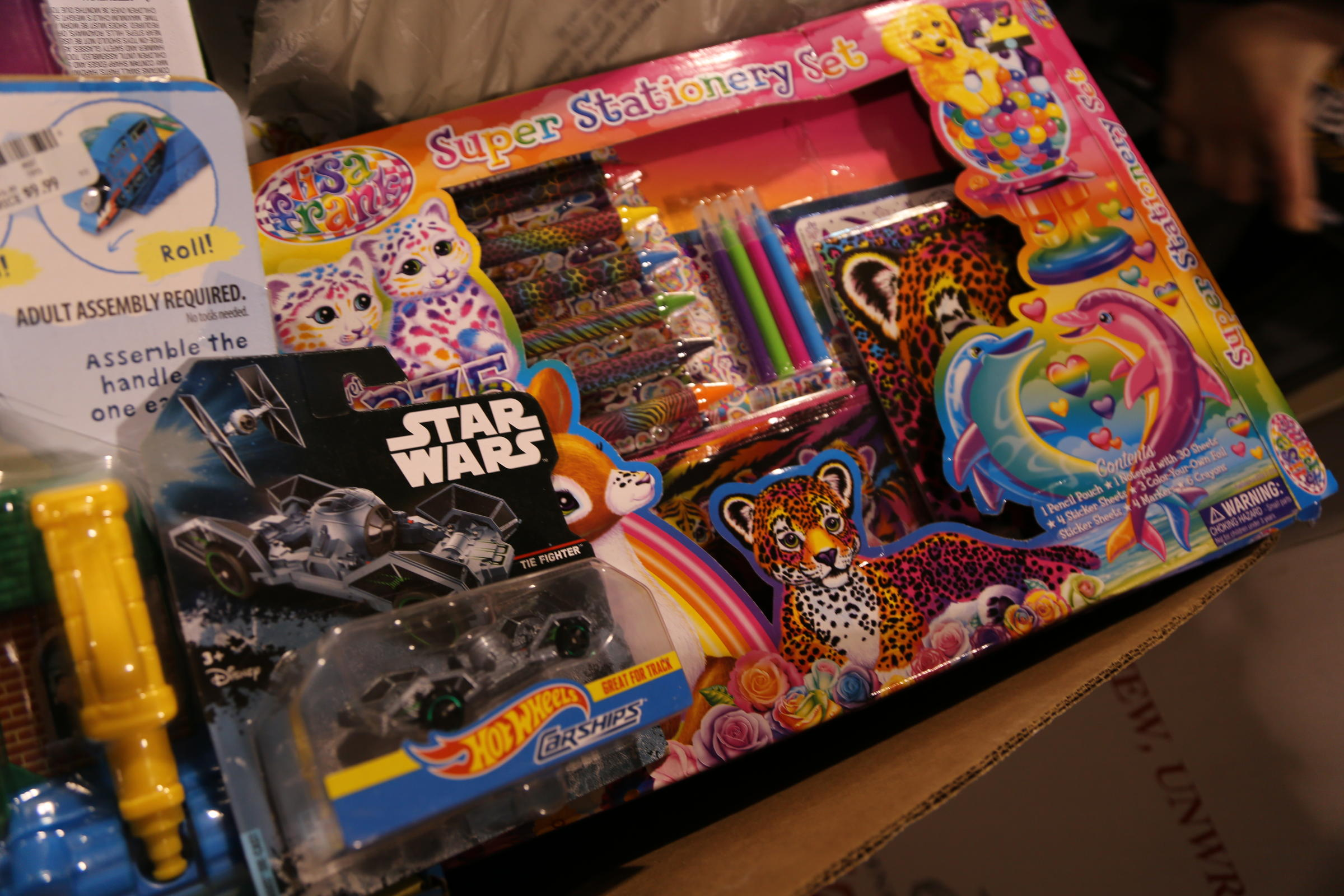 Volunteers Have Selected Both Star Wars And Stationary Gifts To Place In The Girls Bin At A Toys For Tots Collection Packaging Event West Mifflin