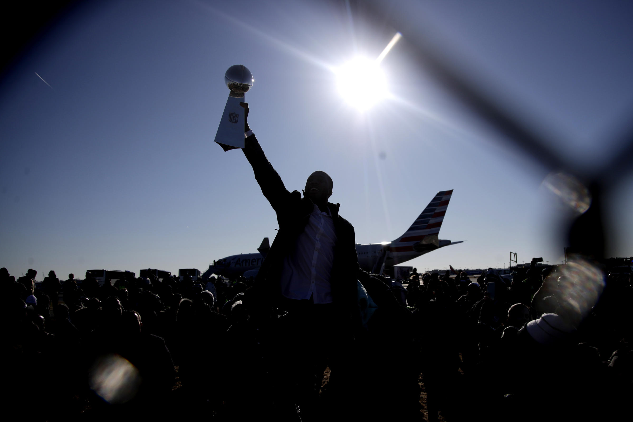 Philadelphia Eagles Wide Receiver Nelson Agholor Holds Up The Vince Lombardi Trophy While Displaying It To