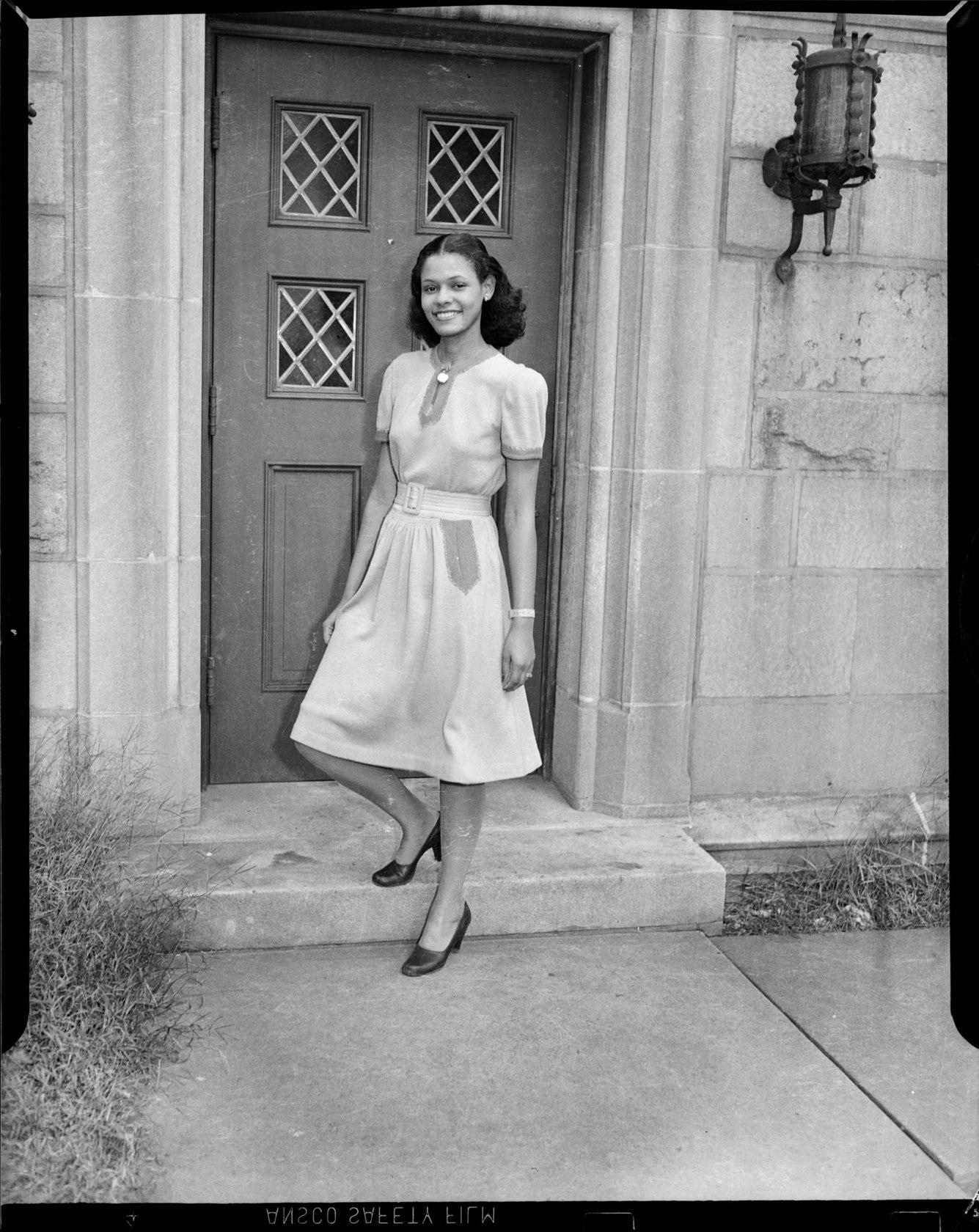 2fd472fc83bab Portrait of Mildred Allen posed on a step in front of the Falk School at  the University of Pittsburgh in Oakland in September 1945.
