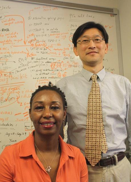 Azah Mohamed and cancer researcher Dr. Peter Wang