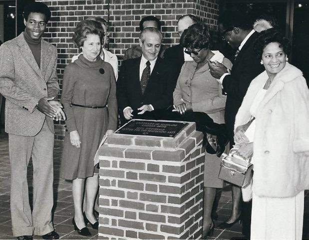 Platform dignitaries unveil the Ella Fitzgerald dedication plaque.
