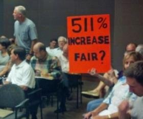 Mecklenburg County residents protest the property tax revaluation at an August 2012.