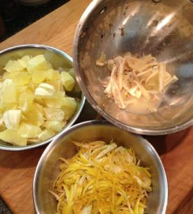 Here you have the chopped seedless fruit, the sliced zest and the trimmings from seed removal in separate bowls. Place all of the trimmings into cheesecloth, tie it and put into the pot to cook with the fruit, water and sugar. You will want to remove it after cooking. Add the same amount of water, sugar, and the fruit and peel to a deep heavy bottomed pot.