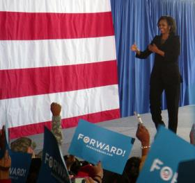 First Lady Michelle Obama greets a crowd of supporters in a hangar in Charlotte Monday afternoon.