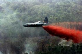 An Air National Guard C-130 Hercules equipped with modular airborne firefighting systems, similar to this one, dropped thousands of gallons of retardant on the wildfires in South Dakota.