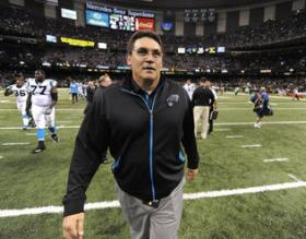 Carolina Panthers head coach Ron Rivera walks off the field following the team's victory over the New Orleans Saints at the Mercedes-Benz Superdome in New Orleans. The Panthers defeated the Saints 44-38 on Sunday.
