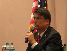 N.C. Gov. Pat McCrory talks to a group of elected officials in Charlotte.