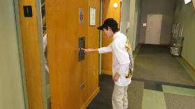 12 year old T.J. Burns calls the elevator outside of the WFAE studios.