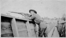 Unnamed soldier practices at Camp Greene rifle range in 1918.