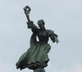 A statue of Queen Charlotte, for whom the city was named, greets travelers at Charlotte Douglas International Airport.