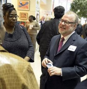 Charlotte city manager candidate Ron Carlee meets and mingles at a reception Wednesday night.