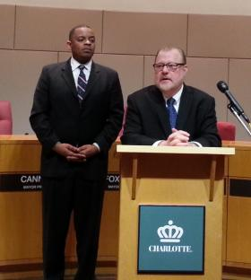Mayor Anthony Foxx watches on as newly-appointed Charlotte City Manager Ron Carlee speaks to the media.