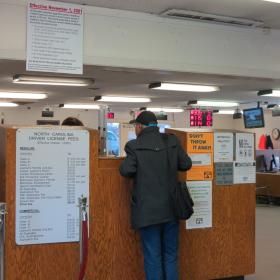 A counter at the DMV office in the University City area. The current average wait time at North Carolina DMV offices is between 20 and 50 minutes.