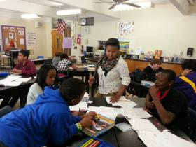 NaToya Dingle talks to a group of her 8th-grade biology students at Coulwood Middle School.